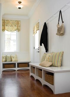 Mudroom/laundry room(Clean look for sitting to put shoes on or off, hooks for purse, book bags, coats, baskets for shoes, or whatever).