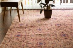 This is Blossom. She's a beautiful 60 year old, distressed blush pink/peachy 8x5' vintage Turkish flat-pile Kilim rug. Blossom has a muted, all-over floral pattern that makes her a perfect fit as a di