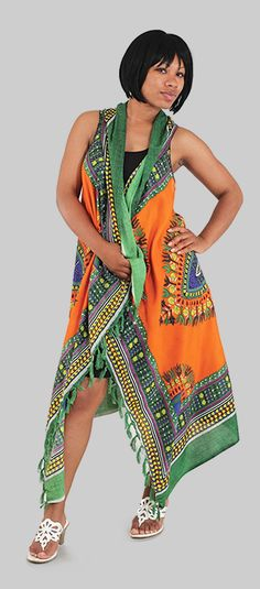 Traditional African Print Sarong in green and orange - Beautiful and bold African traditional prints on a lightweight sarong perfect for wearing over a light dress or wearing at the beach with your swim suit.  Celebrate your love of African culture and history with this beautiful traditional African print on a versatile sarong.  The sarong is both comfortable and classy, so its perfect for traveling, wearing to the beach, or getting as gifts for friends and family.  #african #africa #fashion