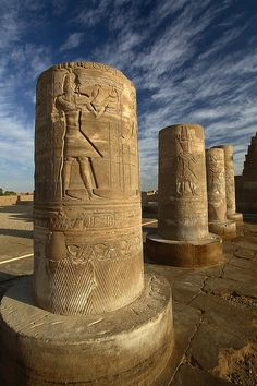Temple of Kom Ombo~The spectacular riverside setting of the temple of Sobek and Haroeris in Kom Ombo. Pillars of the partly Roman forecourt of the Temple.
