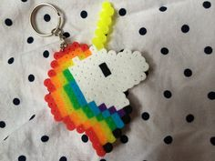 Hey, I found this really awesome Etsy listing at https://www.etsy.com/listing/194999042/rainbow-unicorn-perler-bead-keychains
