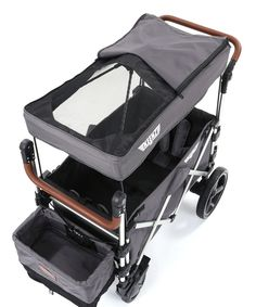 Packed full of useful features, this stroller wagon is designed with the on-the-go family in mind. Built-in storage provides plenty of room to stow and organize gear, and a retractable sun canopy provides shade from the sun. Two adjustable handles ensure superior handling, while spring-suspension wheels offer a smooth ride. Weight capacity: 110 lbs.34'' W x 19.5'' H x 34.6'' DFive point safety harnessOne step on/off brakeBuilt-in cushioningBuilt-in locking strapsTwo adjustable…