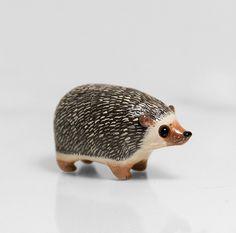 Hedgehog Figurine OOAK Handmade Polymer Clay Animal Totem by RamalamaCreatures on Etsy https://www.etsy.com/listing/203765330/hedgehog-figurine-ooak-handmade-polymer