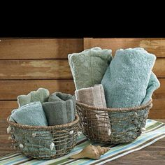Sam's bathroom. Replace cabinet w/white shelves. Put hand towels and wash tags (green, blue, grey,beige) in baskets for display.