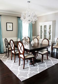 modern home. AM Dolce Vita: Dining Room Chandelier Reveal, dining room crystal chandelier, trellis area rug, double pedestal dining room, oval back Louis dining chairs