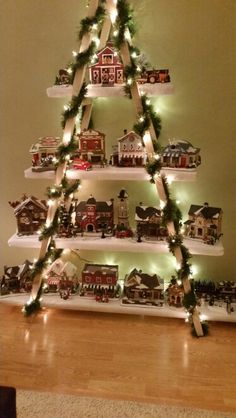 Christmas village displayed on old wooden ladder. | Christmas ...