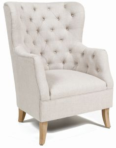 Love the tufted back on this club chair! Perfect accent piece for a charming living room.  #classichome