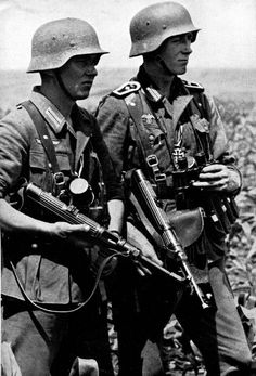 Crimea, 1942: Two German grenadiers (the one on the right, a sergeant) armed with the MP-38 SMG photographed shortly after receiving the Iron Cross 2nd Class for bravery. The medal can be seen hanging from a buttonhole on the sergeant's tunic and similarly for the other grenadier.