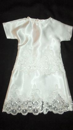 This looks like an earlier one but is in a larger size using two panels of lace.