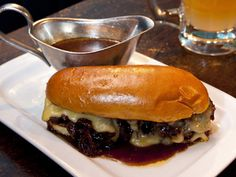 Ox cheek French dip at Hawksmoor Spitalfields BarThere are many reasons for visiting any of Hawksmoor's three branches, but if you're in for cocktails rather than a three-course, beef-based blowout and merely need some sustenance, then go French. This is sandwich perfection – braised ox cheek with Ogleshield Jersey cow's milk cheese, layered in a slightly sweet finger roll, served with an order of mahogany marrow gravy, which is the delicious dip.