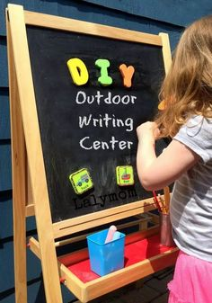 Set up an outdoor writing activity for your kids this spring. LalyMom put together this writing activity with an easel and some chalk. Your kid will have fun practicing writing while being outside. #activites #writingskills