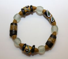 This stretch cord bracelet includes all recycled glass Krobo beads made in Ghana, West Africa: All proceeds go to help build the computer lab at SDA School in the village of Ankaase. Size: small (7 inches around). $20. www.armsaroundankaase.storenvy.com