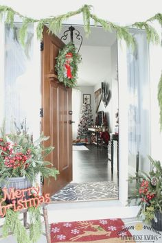 Check out this Christmas home tour! I love the pops of red, black, and plaid!