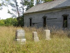 Gravestones in an abandoned cemetery.   Saint John's Evangelical Lutheran (Gospel Center)  Cemetery Maxville, Ohio