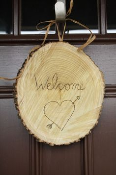 rustic valentine door decor using woodburning tool from @Cassie Bustamante for the DIY Club