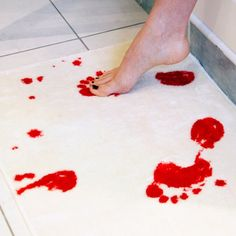 """Bloody"" bathmat...it turns red when it gets wet! So cool!"