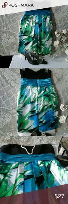 """Colorfull formal dress! Strapless with pleated waist, pleats in front and two side pockets. Back zipper. Lining 100% polyester,  contrast 92% polyester,  8% spandex. Worn 2x. Great condition.  Size 11, colors: green black, blue and white pleated satin waist, satin feel and look, armpit to armpit 15 1/2"""", waist 29"""", length  29"""". City Studio Dresses Mini"""