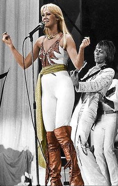 Here's a great shot of Aggie in the now famous tight white outfit she wore during the Australian tour(1977). They say this was the first time a girl like her wore such an outfit on stage and it's little wonder that it was created specifically for her. After all no woman-before or since-has ever been able to make a piece of clothing sing quite like Ms. Faltskog could.