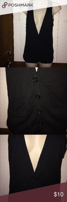 Women's Limited sweater vest Women's limited extra small sweater vest. It's black with five buttons down the front and two pockets it's from a smoke free home. The Limited Other