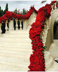 Stunning floral wedding staircase decor with red roses