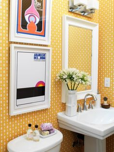 Graphic yellow wallpaper and vintage Spanish movie posters provide a pop-art feel to this bathroom. Source: Canadian House and Home Decor, Bathroom Wallpaper, Bathroom Styling, Small Bathroom, Sink Inspiration, Yellow Bathrooms, Bathroom Decor, Beautiful Bathrooms, Bathroom Inspiration