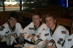 Conor Garland, William Messa, and Mike Brodzinski pose for a picture at the Lumberjacks Meet and Greet at Buffalo Wild Wings on Wednesday, Sept. 26, 2012 #USHL