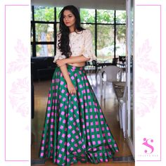Deck yourself up in the beauty that the mix of subtlety and loud creates! Get yours customized from the  Swapna Roa Studio . Beautiful green and pink color checks lehenga and ivory crop top. 22 February 2018