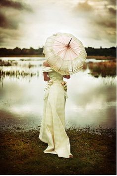 An umbrella is a lovely and practical addition to any wedding day ensemble. Find umbrella's for rent and/or sale at splendorforyourguests.com!  Splendor for Your Guests | Rental Company | Weddings | Events | Shawls | Blankets | Umbrellas | Parasols | Fans