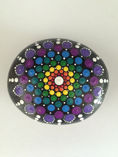 A personal favorite from my Etsy shop https://www.etsy.com/listing/452345012/large-rainbow-mandala-stone-hand-painted
