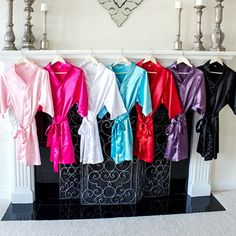 Personalized Colorful Satin Bridesmaid Robes wit Embroidered Names.  Love these for the girls for the day of.  Each girl can wear a different color to suit their personality or one color to match the wedding colors.