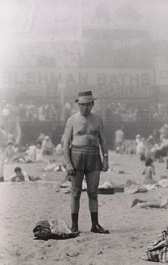 Man in hat, trunks, socks and shoes, Coney Island, NY, 1960