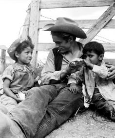 James Dean on the set of Giant with some local children, 1955.