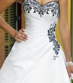 I am in love with the black detailing on this dress! I want, I want, I want.