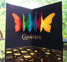 hand crafted congrats card .. open view of butterfly Pop-Up by ruby-heartedmom ... brightly colored die cut butterflies on black ... luv it!!