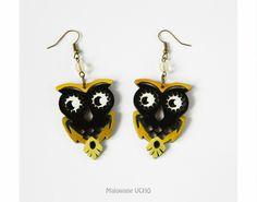 Black and gold owls painted on wood