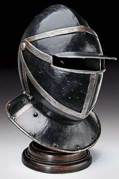 A black and white cuirassier's helmet, dating: 17th Century  provenance: Germany