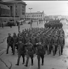 Officers and enlisted servicemen of the Mongolian People's Army marching through Sukhbaatar Square in Ulaanbaatar at the 1953 Mongolian Revolution Day Parade.
