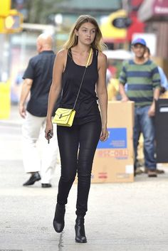 Gigi Hadid wearing Bvlgari Serpenti Forever Shoulder Bag and A Gold E Sophie Jeans in Stargaze