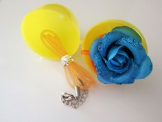 A handmade blue flower necklace. magnet, and message holder. Fillers #Easter #EasterEgg #EasterEggFillers #CuteGifts