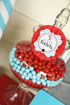 Candy at a Dr. Seuss Party. Sixlets come in some great Seuss colors. Put them in a glass jar, and you have a very pretty treat!