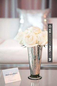 Neat - A mercury bud vase gets the metallic treatment in this wedding decor, complete with an event-specific hashtag so guests can share their wedding photos in real time. See more  decor inspiration: | CHECK OUT MORE FANTASTIC PICTURES OF GREAT WEDDING DECOR TRENDS 2015 AT WEDDINGPINS.NET | #weddingdecor2015 #weddingdecor #decor #2015 #trends #weddings #weddingvows #vows #tradition #nontraditional #events #forweddings #iloveweddings #romance #beauty #planners #fashion #weddi