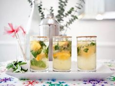 Pair sweet citrus infusions with mint sprigs and orange slices to create the perfect winter spritzer. Rim the glasses with edible gold glitter for a glamorous touch.