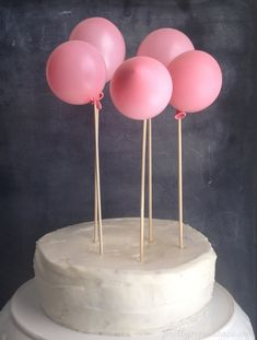 Such a sweet way to decorate a cake (skewers + little balloons half blown up).