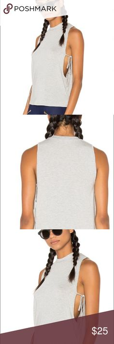 Lovers + Friends heather grey leisure tank S This tank was purchased on revolve.com and worn twice. This comes from a non smoking home and is in excellent condition! Description: -95% modal, 5% spandex -heather grey -size Small -runs true to size -machine washable Lovers + Friends Tops Tank Tops