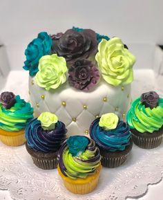 Teal, Green, and Purple Rose Themed Cake and Cupcakes - Mueller's Bakery Cupcake Cakes, Cupcakes, Top Hats, Floral Cake, Purple Roses, Teal Green, Themed Cakes, Birthday Cakes, Bakery