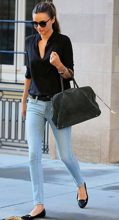 Black elbow sleeve top, light blue skinny jeans, black flats, sunglasses, ponytail | street style casual fashion oufits