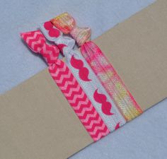 Perfectly Pink Mustache Hair Ties by ShillysFrillies on Etsy, $3.30