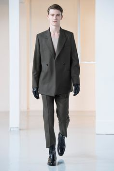 18. Tailored double-breasted jacket and suit pants in heavy wool flannel, tank top in cotton-cashmere jersey, gloves in lambskin leather, ankle boots in leather