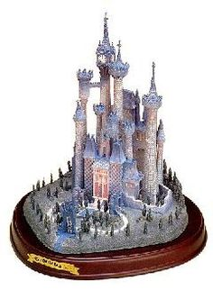 WDCC Disney Classics Cinderella's Castle #WDCCDisneyClassics #Art. Cinderella's Castle was released as part of the Enchanted Places.  Sculpture comes with a wood base with engraved brass nameplate.  Retired 01/98.