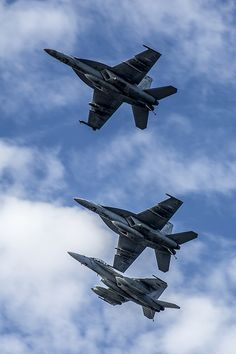 """SOUTH CHINA SEA (July 1, 2014) Three F/A-18F Super Hornets from the """"Diamondbacks"""" of Strike Fighter Squadron (VFA) 102 fly over the flight deck of the U.S. Navy's forward-deployed aircraft carrier USS George Washington (CVN 73). (U.S. Navy photo by Mass Communication Specialist 3rd Chris Cavagnaro/Released)"""